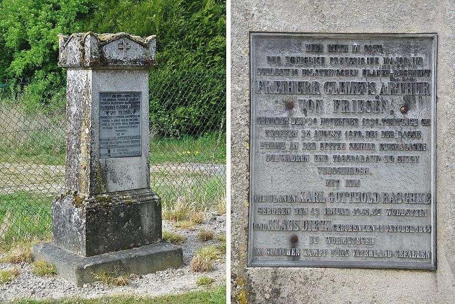Remarkable gravestone of a German major and two of his comrades, fallen in Sivry during the Franco-Prussian War (1870). The stone stands in the cemetery of Sivry, next to the church (municipality Sivry-Ante, Marne department, Champagne-Ardenne region, France). The text on the grave reads:  HIER RUHT IN GOTT DER KOENICHLICH PREUSSISCHE MAJOR IM SCHLESWIG HOLSTEINSCHEN ULANEN-REGIMENT FREIHERR CLEMENS ARTHUR VON FRIESEN, GEBOREN DEN 20 NOVEMBER 1826, TOEDTLICH GE TROFFEN 25 AUGUST 1870, BEI DER BASSE FERME AN DER SPITZE SEINER EHEMALIGEN SCHWADRON UND TAGSDARAUF ZU SIVRY VERSCHIEDEN, MIT IHM  DIE ULANEN KARL GOTTHOLD RASCHKE GEBOREN DEN 12 JANUAR 1843, ZU WOLLSTEIN UND KLAUS DIECK GEBOREN DEN 11 OKTOBER 1845 ZU WORMSTEGEN IM GLEICHEN KAMPF FÜRS VATERLAND GEFALLEN