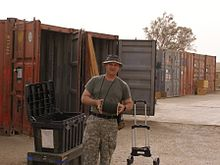 GI loads a shipping container.jpg