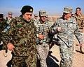 Gen. Bismillah Mohammadi listens to Lt. Gen. Caldwell while visiting an ANA camp (4251534286).jpg