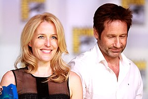 The popular TV series The X-Files depicts the fictional FBI Special Agents Dana Scully (Gillian Anderson) and Fox Mulder (David Duchovny) who investigate paranormal phenomena. Gillian Anderson & David Duchovny (9344570889).jpg