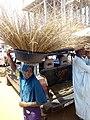 Girl hawking brooms at Oja Oba, Ilorin, Kwara State 03.jpg