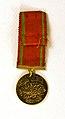 Gold Liyakat Medal (miniature, reverse).jpg
