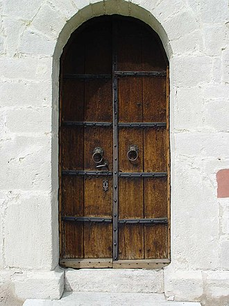 "Compatibilism - Saying ""there may be a person behind that door"" merely expresses ignorance about the one, determined reality"
