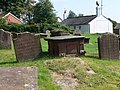 Gravestones at St Nicholas', Burton-in-Wirral - geograph.org.uk - 1495721.jpg