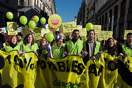 Greenpeace activists, demanding 100% renewable energy at Climate March 2015 in Madrid. Greenpeace Climate March 2015 Madrid.jpg
