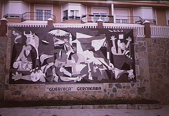 "Guernica - A tiled wall in Guernica claiming ""the Guernica painting to Guernica"" (currently in the Museo Reina Sofía)"