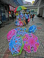HK 觀塘 Kwun Tong 巧明里 How Ming Lane street stall colorfull umbrella April 2013.JPG