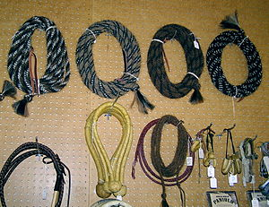 Vaquero - Classic vaquero style hackamore equipment. Horsehair mecates top row, rawhide bosals in second row with other equipment