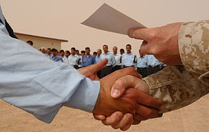 Handshake - Shaking with the right hand while delivering a certificate with the left