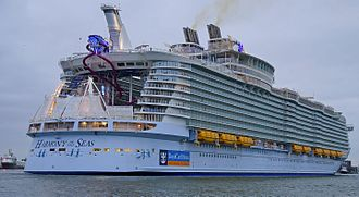 "Harmony of the Seas - The aft of Harmony of the Seas, with the Aqua Theater and ""Ultimate Abyss"" slides visible"
