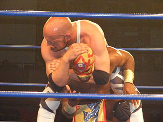 Ares (wrestler) - Ares performing a sleeper hold on Amasis.