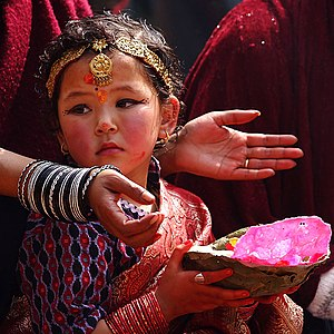 Hindu - A young Nepali Hindu devotee during a traditional prayer ceremony at Kathmandu's Durbar Square
