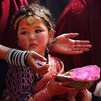 Hindu - A young Nepali Hindu devotee during a traditional prayer ceremony at Kathmandu's Durbar Square