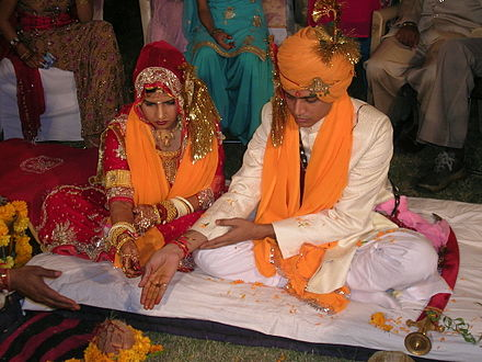 Hindu marriage ceremony from a Rajput wedding. Hindu marriage ceremony offering.jpg