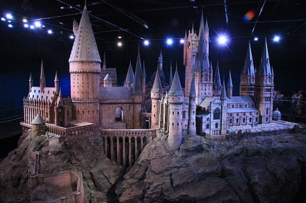A studio model of Hogwarts. It is the main setting in the series; the castle features in every novel and screen adaptation. Hogwarts model studio tour.jpg