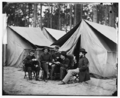 Hospital stewards of 2d Division, 9th Corps, in front of tents.png