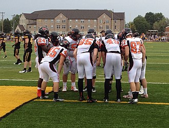 Huddle - Baker Wildcats huddle up during a game