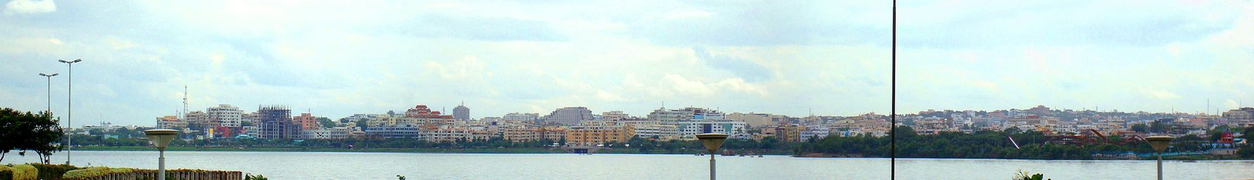 a view of buildings along located on the banks of lake