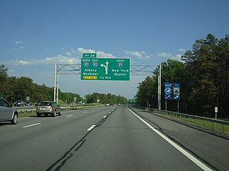 Interstate 90 in New York - Overhead signage for exit 24 in Albany, where I-90 leaves the Thruway mainline to serve downtown Albany.