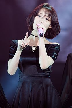 IU performing at her 24 Steps Concert in Seoul (2016).jpg