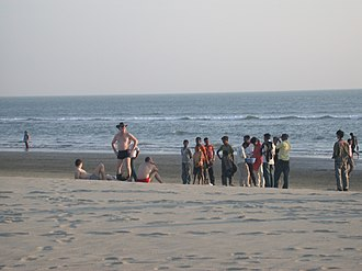 Modesty - Three Ukrainian men, wearing trunks and briefs, attract attention for immodesty relative to the local norm in Cox's Bazar, Bangladesh.