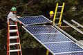 Installing solar panels (3049873452).jpg