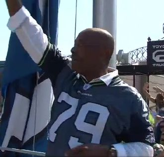 Jacob Green - Jacob Green raises the 12th Man flag at Qwest field September 13, 2009