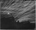 Japanese night raiders are greeted with a lacework of anti-aircraft fire by the Marine defenders of Yontan airfield... - NARA - 532363.tif