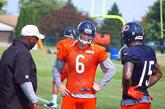 2012 Chicago Bears season - Quarterback Jay Cutler (center) talks with Brandon Marshall (right) during training camp