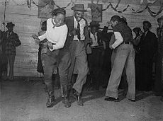 Dancing in a juke joint outside Clarksdale, Mississippi; November 1939.