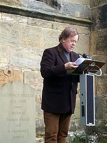 Jonathan Meades reading on Sterne's grave 2012.jpg
