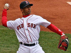 Julio Lugo of the Boston Red Sox warming up be...