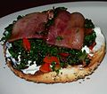 Kale, Red Peppers, Bacon and Cream Cheese on a Bagel (8616846977).jpg