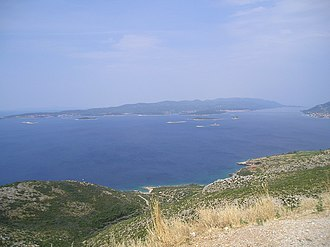Korčula - A panoramic view of the easternmost parts of Korčula, with Lumbarda, City of Korčula and Orebić (Pelješac) from left to right