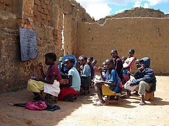 Education in Angola - Children in an outdoor classroom in Bié, Angola