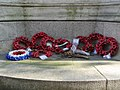 LNWR War Memorial, Euston - poppies at base of north elevation.jpg