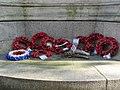 LNWR War Memorial, Euston - poppies at base of north elevation.jpg
