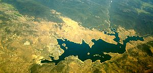 Jindabyne Dam - An aerial view of Lake Jindabyne, with the dam wall pictured bottom left, 2009.