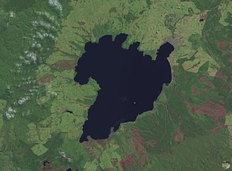 Geography of New Zealand - The scalloped bays indenting Lake Taupo's northern and western coasts are typical of large volcanic caldera margins. The caldera they surround was formed during the huge Oruanui eruption.