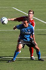 Landon Donovan fighting a ball against Carlos Bocanegra during MLS Cup 2003.