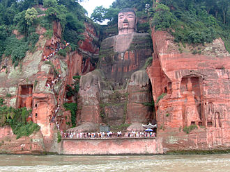 Stone carving - The Tang Dynasty Leshan Giant Buddha, near Leshan in Sichuan province, China. Construction began in 713, and was completed in 803. It is the largest stone-carved Buddha in the world.