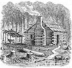 English: A settler's log cabin
