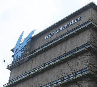 Vrije Universiteit Amsterdam - The upper floors of the Main Building's eastern wing, housing library stacks and showing the University emblem.