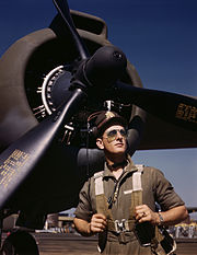 """U.S. Army test pilot Lt. F.W. """"Mike"""" Hunter wearing a flight suit. Image from the Office of War Information, 1942."""