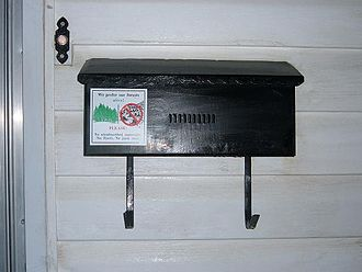 Letter box - An attached or wall-mount letterbox, with a hook underneath for newspapers