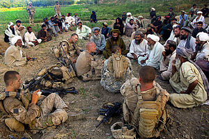 Nawa-I-Barakzayi District - Marines from 1st Battalion, 5th Marine Regiment talk with leaders at a meeting in the Nawa District during Operation Strike of the Sword.