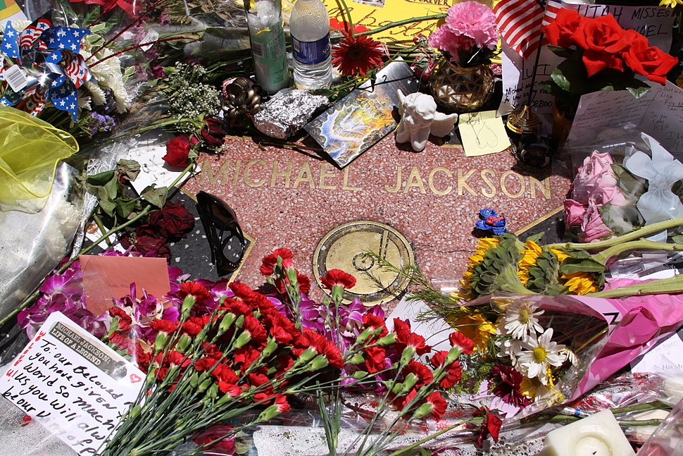 Recording artist Michael Jackson's star, surrounded by flowers, candles, and cards, as observed about two weeks after his death in 2009