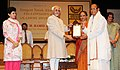 Mohd. Hamid Ansari presenting the Sangeet Natak Akademi Award-2010 to Shri Phanjoubam Iboton Singh, Assam, for his outstanding contribution to Manipuri Dance.jpg