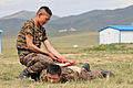 Mongolian Armed Forces practice mechanical advantage control holds during Non-Lethal Weapons Executive Seminar (NOLES) 13 at the Five Hills Training Area in Mongolia Aug. 18, 2013 130818-M-DR618-053.jpg