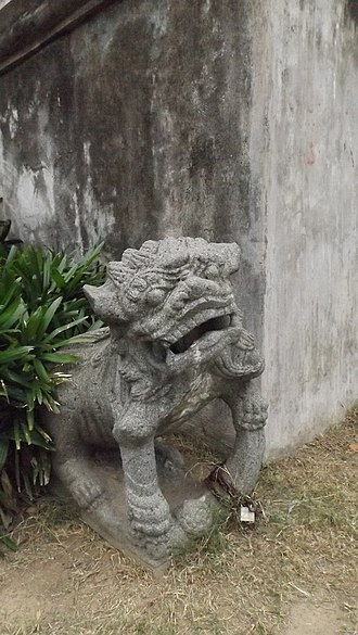 Morong Church - One of the lion sculptures at the side of the church. Note the locked chains